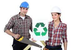 Man and woman stood with saw Stock Image