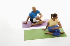 Man and woman stretching. Royalty Free Stock Images