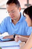 Man and woman studying Royalty Free Stock Image