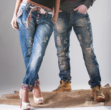 Man and woman in stylish blue jeans royalty free stock images
