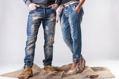Man and woman in stylish jeans royalty free stock photos
