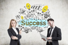 Man and woman with success sketch Stock Photos