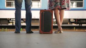 Man and woman with suitcase at train station. Footage of Man and woman with suitcase at train station stock video