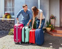 Man woman suitcase trip vacation home house luggage multi-colored pink blue family one ready wait jeans shorts baggage royalty free stock images