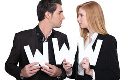 Man and woman in suits Royalty Free Stock Photo