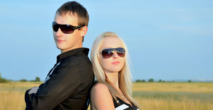 The man and the woman in sun glasses Stock Photos