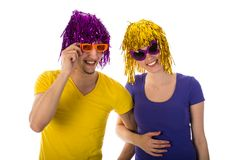 Man and woman with sunglasses and carnival wigs Royalty Free Stock Images