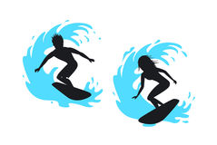 Man and woman surfer silhouettes. Riding on a wave Stock Photo