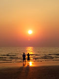 Man and woman sweet lover on the beach with sunset Stock Photo