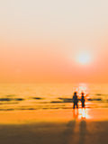 Man and woman sweet lover on the beach with sunset. Burry In a dream frame man and woman sight seeing on the beach with sunset abstract Stock Photography