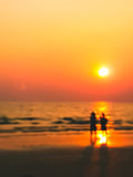 Man and woman sweet lover on the beach with sunset. Burry In a dream frame man and woman sight seeing on the beach with sunset abstract Royalty Free Stock Image