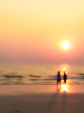 Man and woman sweet lover on the beach with sunset. Burry In a dream frame man and woman sight seeing on the beach with sunset abstract Royalty Free Stock Images
