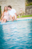 Man and woman by swimming pool having fun Royalty Free Stock Photography