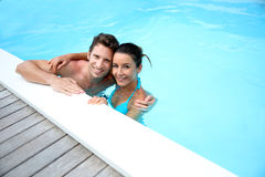 Man and woman in swimming pool royalty free stock images