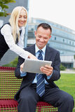 Man and woman with tablet computer Royalty Free Stock Images