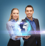 Man and woman with tablet pc Royalty Free Stock Image