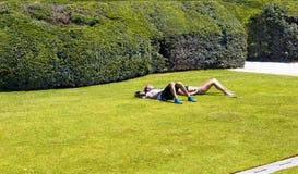 Man and woman take sun bath Stock Photography
