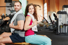 Man and woman taking a break during workout Stock Images