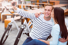 Man and woman taking a photo Stock Photography