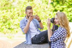 Man and woman taking photos with a camera and a smartphone. royalty free stock images
