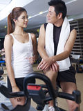 Man and woman talking in gym Royalty Free Stock Photography