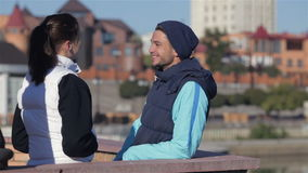 Man and woman talking before jogging. Concept about urban running, sport, fitness and people. Urban sports - couple jogging for fitness in the city on a stock video