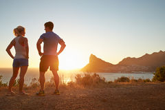 Man and woman talking after jogging Stock Images