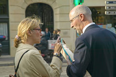 Man and woman talking on street, Paris, France Stock Image