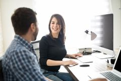 Man and woman talking at work Stock Photography