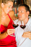 Man and woman tasking wine in cellar Royalty Free Stock Photos