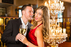 Man and woman tasting Champagne in restaurant Stock Photo