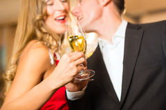Man and woman tasting Champagne in restaurant Stock Image