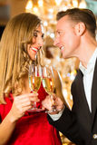 Man and woman tasting Champagne in restaurant Royalty Free Stock Photos