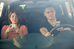 Man and woman texting and driving Royalty Free Stock Image