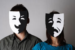 Man and woman in theatre emotions masks. Man and woman in theatre black and white emotions masks Royalty Free Stock Photo