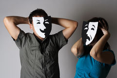 Man and woman in theatre emotions masks. Man and woman in theatre black and white emotions masks, half body Royalty Free Stock Image