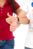 Man and woman with thumbs up Royalty Free Stock Images
