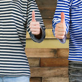 Man and woman with thumbs up Royalty Free Stock Image