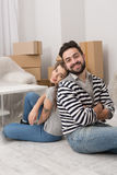 Man and woman tired after preparing to relocation to a newly bought apartment. Stock Photography