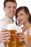 Man and woman toast with oktoberfest beer stei Royalty Free Stock Images