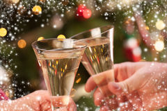 Man and Woman Toasting Champagne in Front of Lights Royalty Free Stock Photos