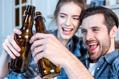 Man and woman toasting Stock Photography