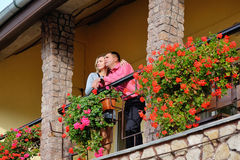 Man and woman together on balcony of their house or hotel with b Stock Image