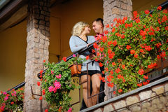 Man and woman together on balcony of their house Stock Photos