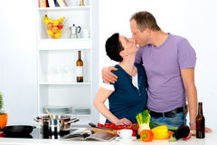 Man and woman together in the kitchen Royalty Free Stock Photo