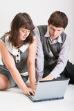 Man and woman together work at the computer Stock Photos