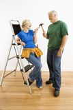 Man and woman with tools and ladder. Royalty Free Stock Image