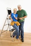 Man and woman with tools and ladder. Royalty Free Stock Images