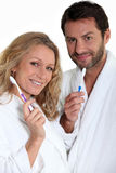 Man and woman with toothbrush Stock Photo