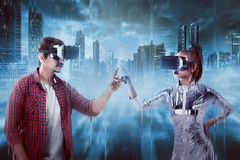 Man and woman touching with finger inside cyber world. Man and women touching with finger inside cyber world. Virtual reality concept Stock Photos